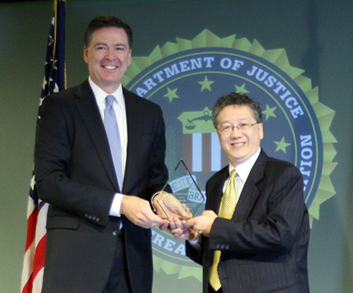 From left: FBI Director James B. Comey, Alan Lai (Photo provided by FBI Seattle Division)