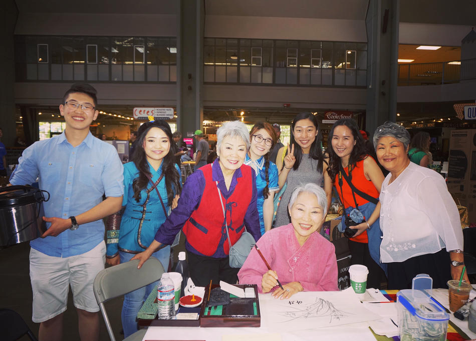 Asia Pacific Cultural Center volunteers with founder, Patsy Surh O'Connell (third from left). (Photo by Assunta Ng/NWAW)
