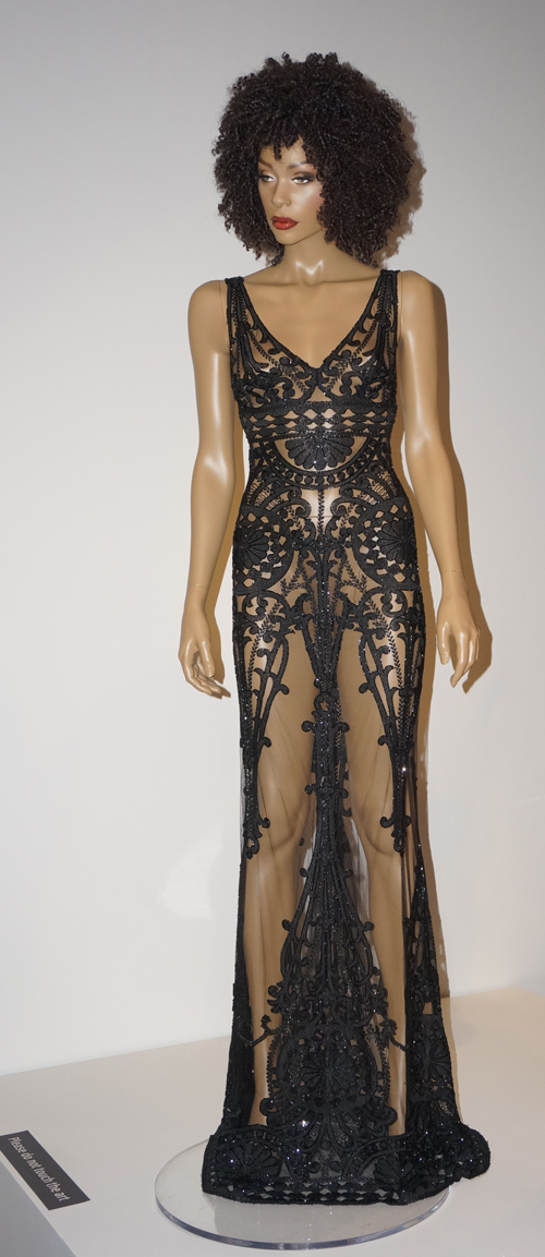 Evening dress with lace hieroglyphs, designed by Sarli. (Photo by George Liu/NWAW)