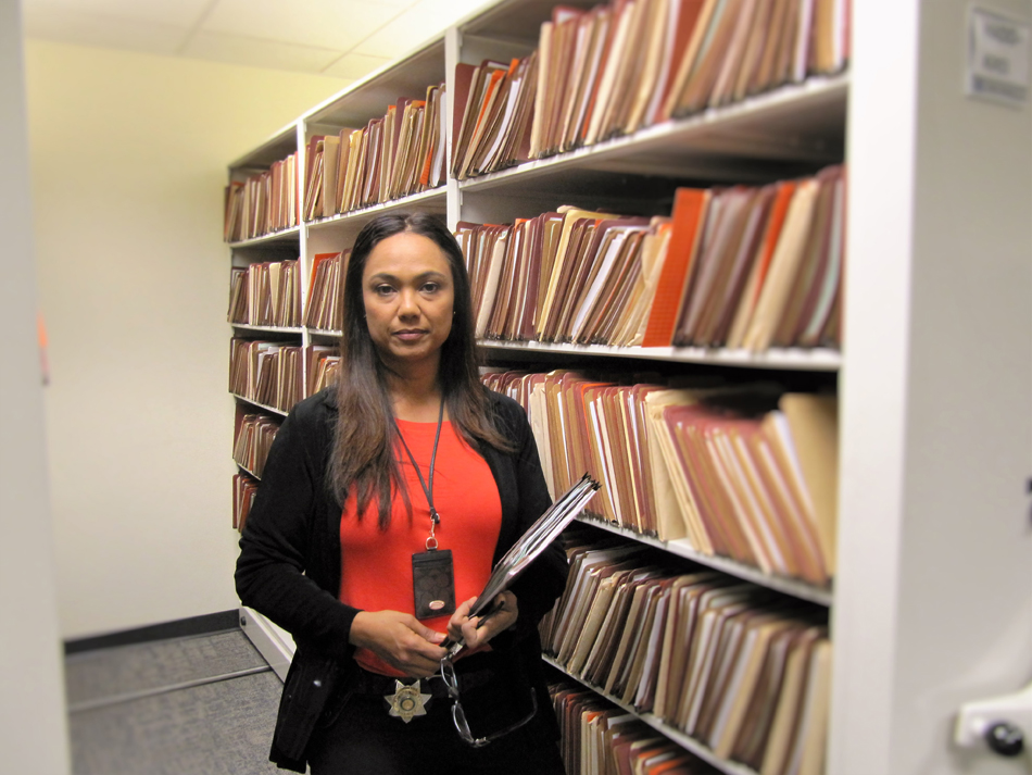 Det. Jessica Santos in the King County file room that has a record of sex offenders and crimes that have affected several lives and families. (Photo by Janice Nesamani/NWAW)