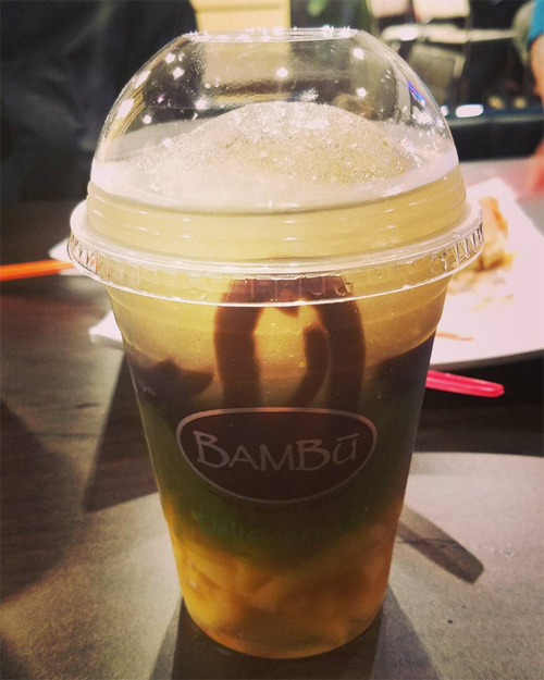Kasey Lay, a frequent Bambu customer, said that she discovered drinks can be customized for $5.25. Shown above is grass jelly, jello, and extra jackfruit in coconut juice. (Photo by Kasey Lau/NWAW)