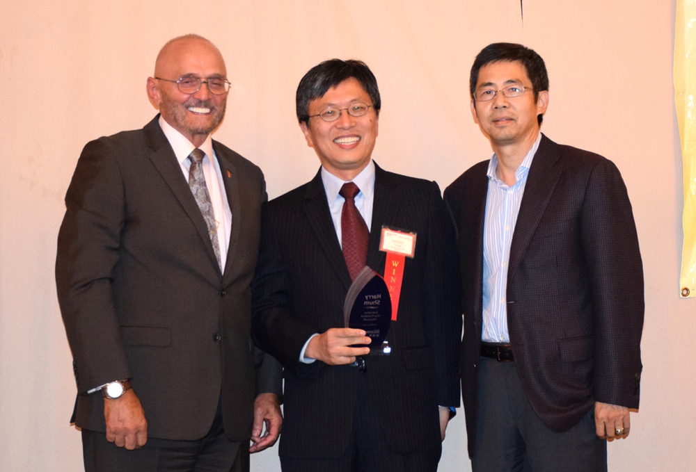From left: Award presenter and event sponsor representative Charles Herrmann (Herrmann Scholbe), honoree Harry Shum (Microsoft), and honoree introducer and sponsor representative Ming Zhang (MZA Architecture).