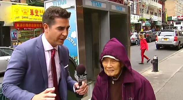 Jesse Watters interviewing a woman in Chinatown in New York on Oct. 6.