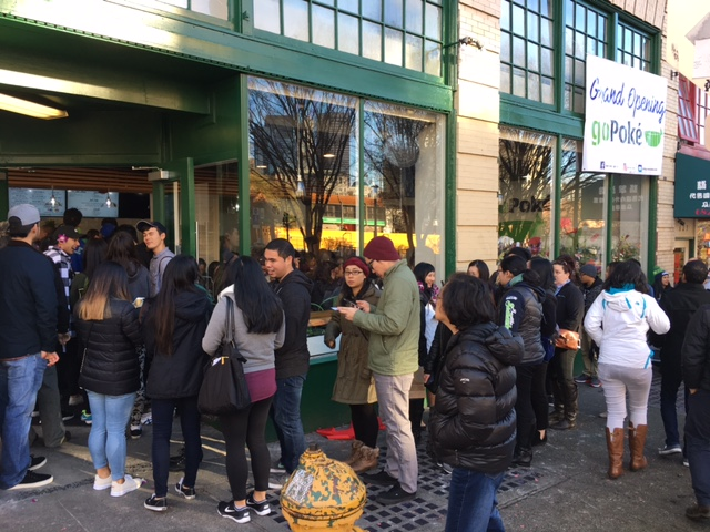 A long line outside goPoké on Dec. 4.  (Photo by John Liu/NWAW)