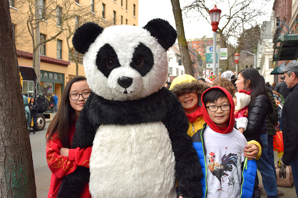 Lena Hou (left), and brother Ian (right), with Leon in the panda costume. (Photo by George Liu/NWAW)