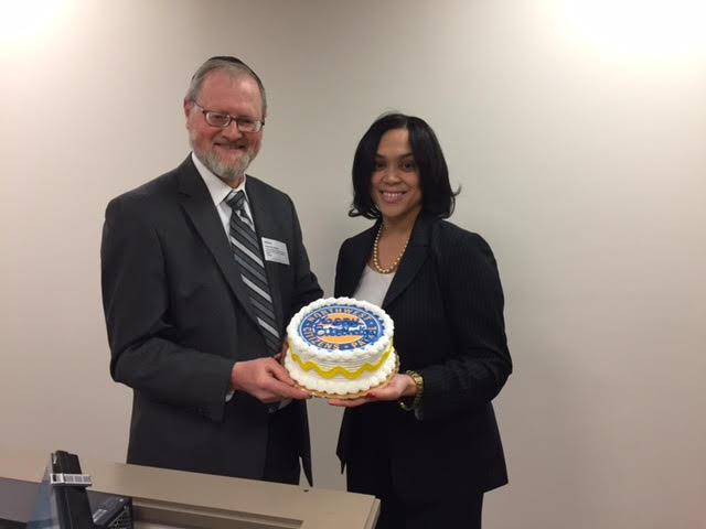 As is custom, NWCP President Neil Schachter presents a birthday cake to Baltimore City State's Attorney on the occasion of her birthday.