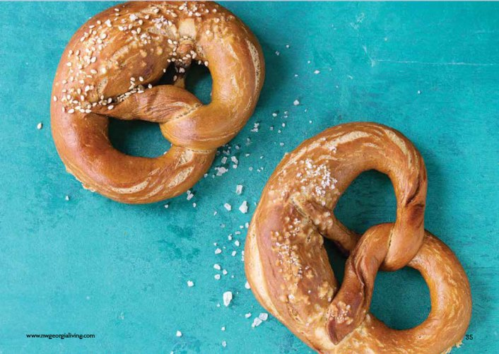 Two pretzels on a blue background.