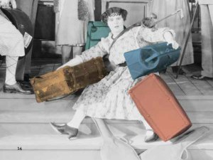 Woman struggling with three suitcases.