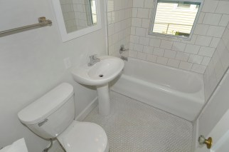 The original tub and floor in the main floor bath were preserved and reused.