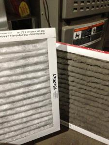 clean and dirty furnace filters shown side-by-side