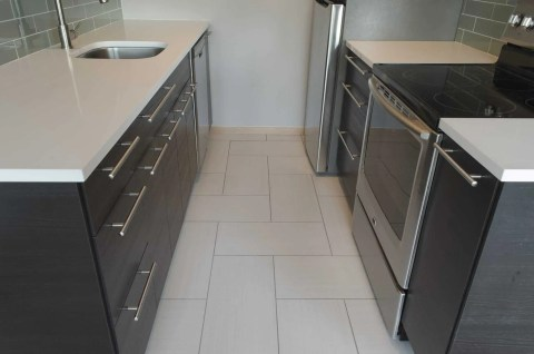 We replaced the 1960s linoleum with this modern porcelain tile