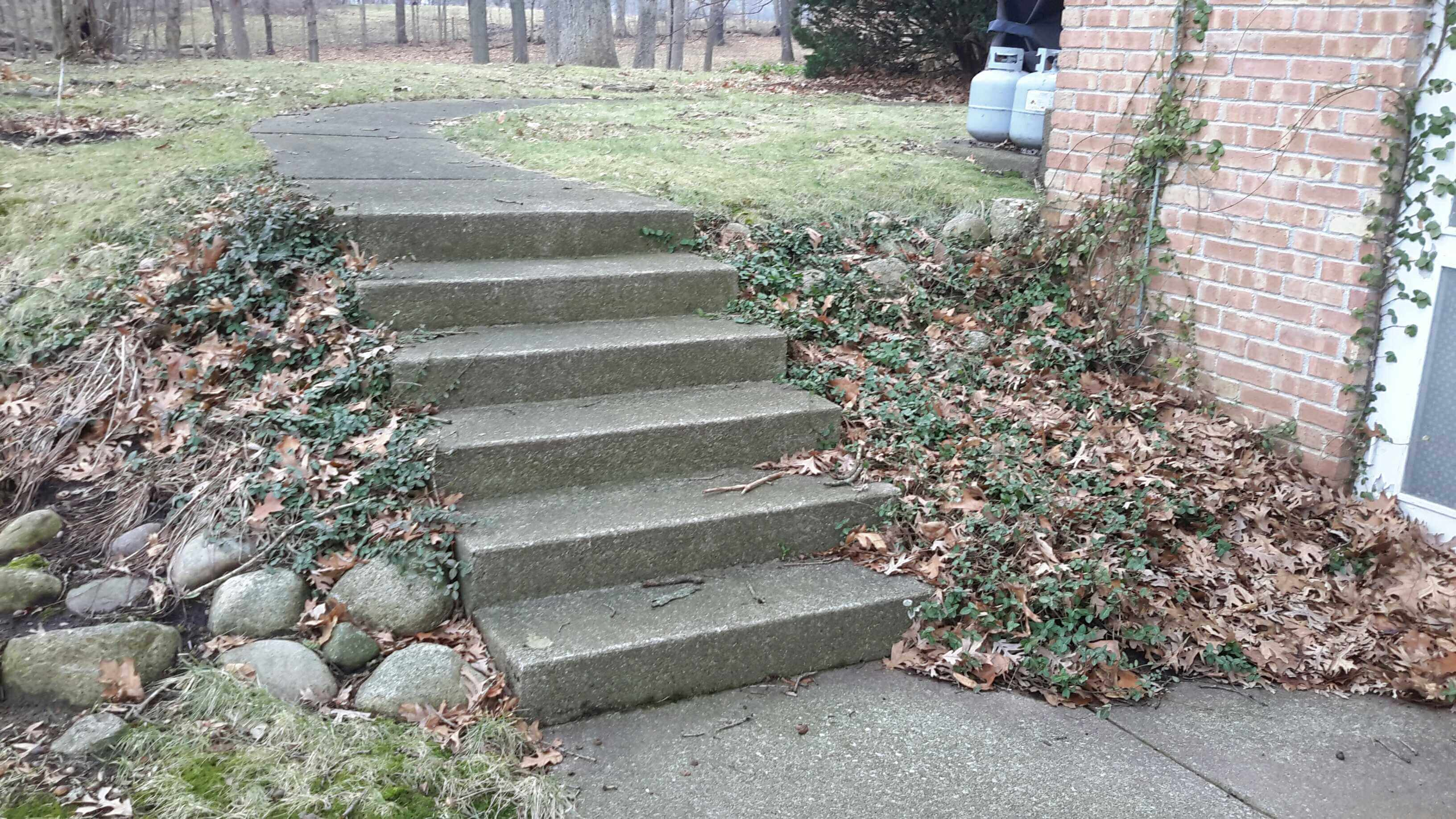 sloped stairs. no guardrail