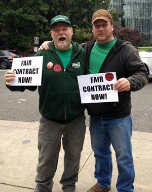 AFSCME Local 189 members Bruce Bullick and Kevin Getner rally outside Portland City Hall Oct. 2 prior to a City Council meeting.