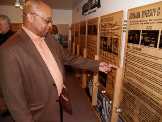 Keith Edwards, a 44-year member of IBEW Local 48, checks out an exhibit  at the Oregon Historical Society featuring the 100th anniversary partnership of NECA/IBEW. Edwards,  the first black business manager of an IBEW local in the nation, retired in December as an international rep.