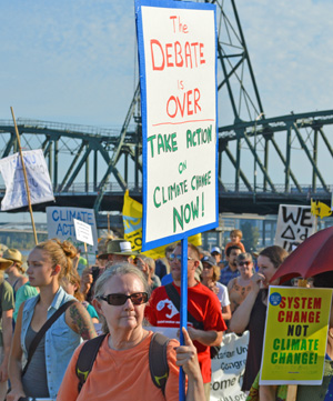 The science is in: It's getting hotter. The only question is what to do about it. At the Sept. 21 People's Climate March in Portland, supporters demand action while marching along Tom McCall Waterfront Park.