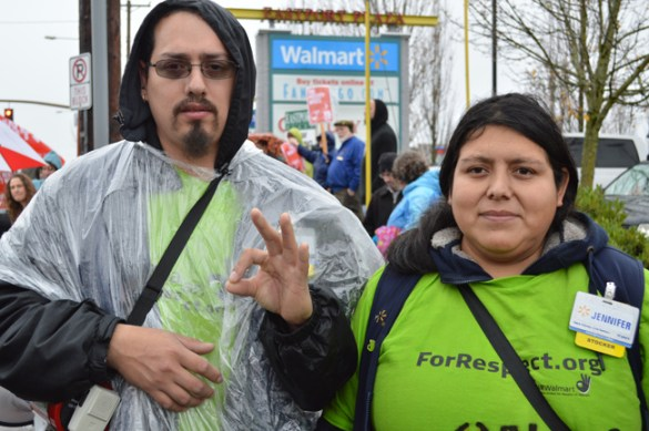 Walmart workers Ismael Nuñez and his wife Jennifer Sanchez, take part in a Black Friday rally Nov. 29 outside a Southeast Portland Walmart. Six weeks later, Nuñez was suspended and terminated on what he says were phony accusations.