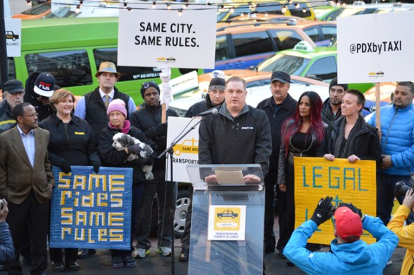 Portland taxi drivers rallied Jan. 13 at Pioneer Courthouse Square. Cab companies want the City of Portland to make ride-sharing companies like Uber play by the same rules as they do.