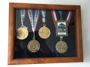 Some of the medals Sam Beekman received running marathons.