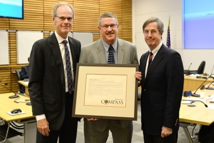 John Mohlis (center) receives Compass Award resolution from Port of Portland Commission President Jim Carter (left) and Port Executive Director Bill Wyatt. (Photo by Jerry McCarthy, courtesy of Port of Portland)