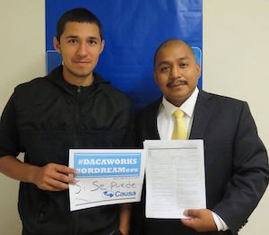 Ricardo Campos and Jonathan Quinonez take part in a recent  immigration clinic at the Oregon Labor Center. (Photo courtesy of Causa).