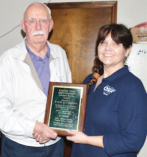 Wayne Anderson receives a lifetime service award from Linn, Benton, Lincoln Counties Labor Chapter President Lisa Gourley.