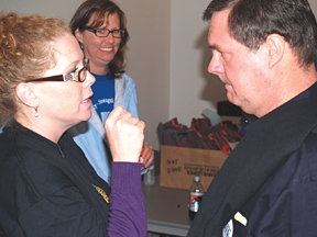 SW Washington Labor Council president Shannon Walker engages Denny Heck in Vancouver September 2010.