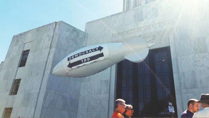 ANTI-TPP blimp in Salem: Members of the United Steelworkers Legislative Committee fly a 25-foot protest blimp over the State Capitol Aug. 23 to denounce Oregon Gov. Kate Brown's support of the Trans-Pacific Partnership.