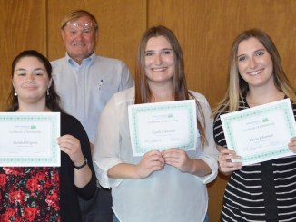 Kids' Chance scholarship recipients from left to right are Zsofika Wigney,  Randi Johnston and Kayla Johnston.  In the back is Bob Shiprack, president of the Kids' Chance board of directors.