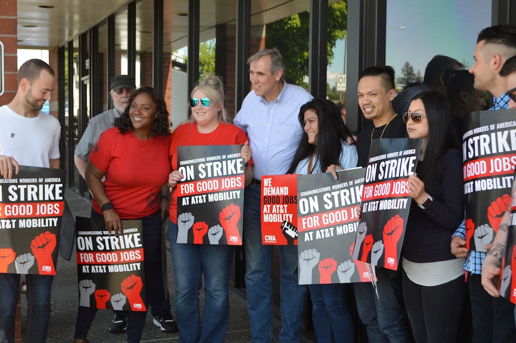 U.S. Senator Jeff Merkley visits a strike picket line May 19 outside the AT&T store at Mall 205 in Portland