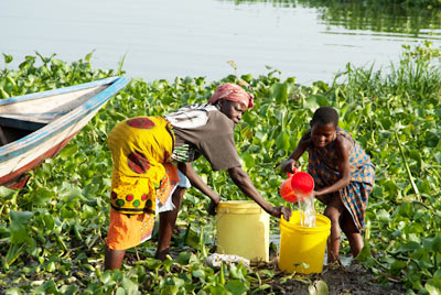 Gathering water from Lake Victoria