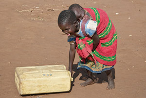 Pregnan girl carrying baby and water