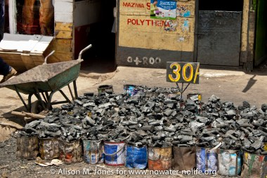 Kenya: Mara River Basin, Nairobi, pots of charcoal for sale for 30 Kenyan shillings each (50 US cents)