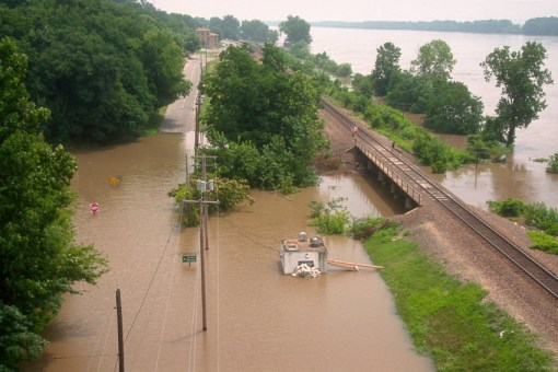 Illinois: Chester, aerial view of Mississippi River flooded over roads in 1993