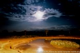 Kenya: Aberdare, Treetops Lodge, waterhole at night with the full moon reflected in water