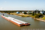 USA: Louisiana, the Atchafalaya Basin, Centerville, Cabot Corp. plant and barge on the IntraCoastal Waterway