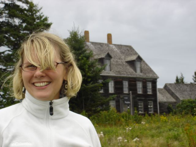 Kim outside of the Olson's house in Cushing, ME where 'Christina's World' was painted.