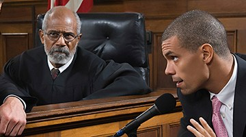 A young lawyer takes the witness stand in court
