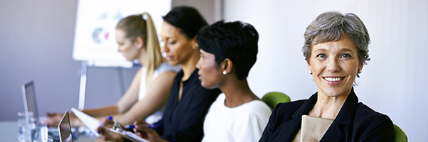 Shot of a group of female coworkers having a meeting in the boardroom