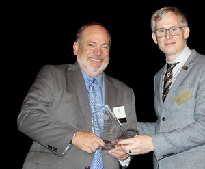 Matthew L. Clucas, recipient of the 2015 Professionalism Award, pictured with WSBA President Anthony Gipe.