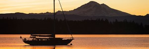 A sailboat at sunset off Lummi Island in Whatcom County.