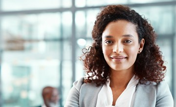 A female attorney smiling