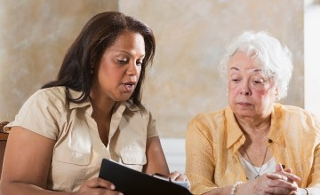 Senior woman getting advice from volunteer female lawyer