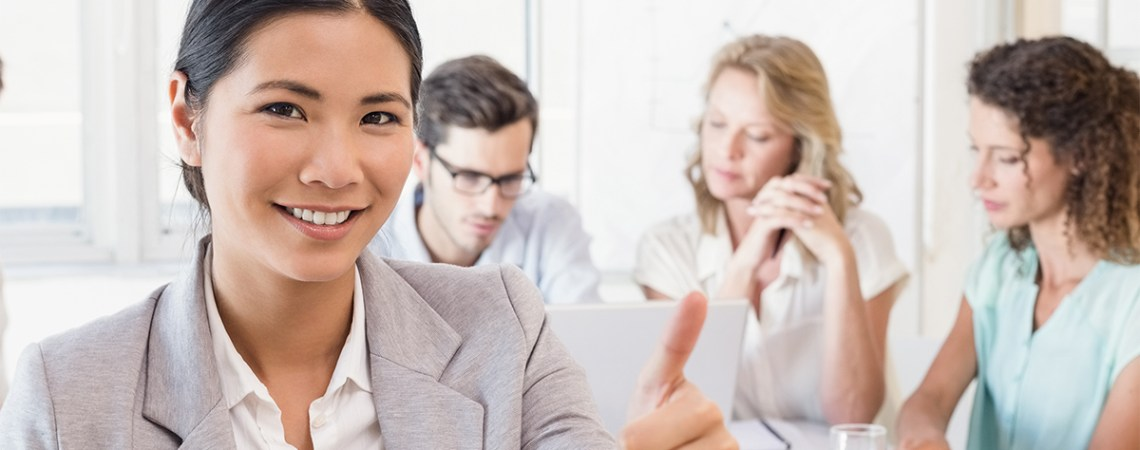 Female lawyer smiling at camera during meeting