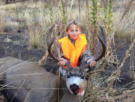 DANE BRUBAKER AND HIS FIRST BUCK, A STUD METHOW VALLEY MULEY THAT WEIGHED 191 POUNDS ON CAMP SCALE. (BROWNING PHOTO CONTEST)