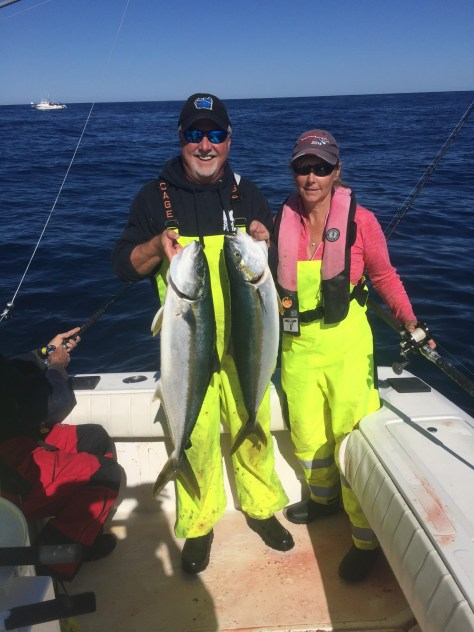 KEVIN AND CYNDI LANIER SHOW OFF TWO OF THE FOUR YELLOWTAIL CAUGHT ABOARD THEIR BOAT THIS WEEK. (KC SPORTFISHING)