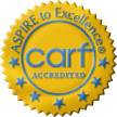 """Image of a gold seal with blue text and blue stars. Text on the seal reads: """"Aspire to excellence. CARF accredited."""""""