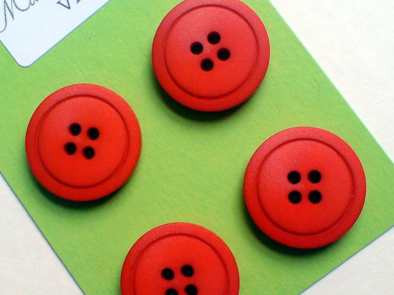 bright orange brushed bakelite buttons