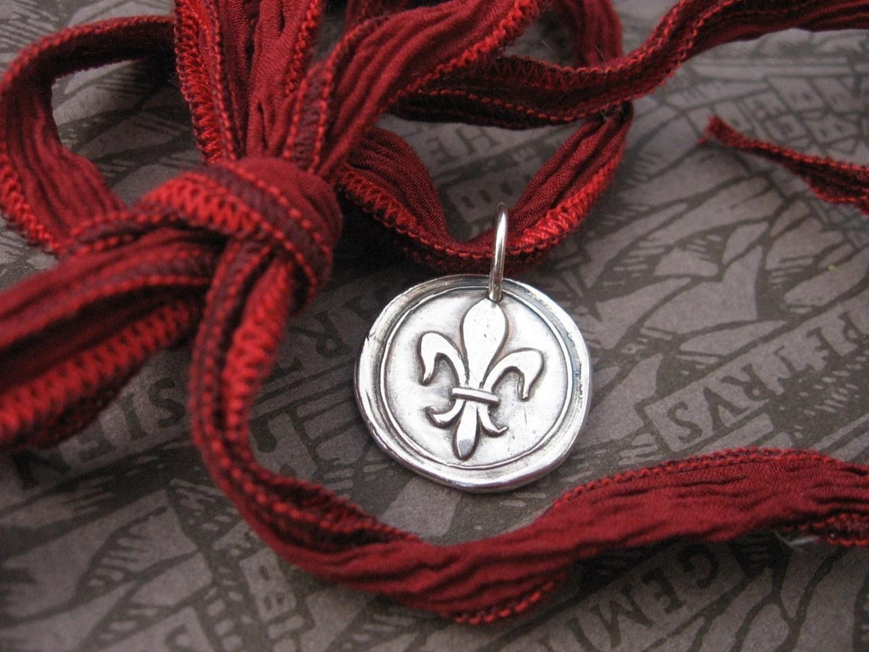 Round fleur de lis Necklace