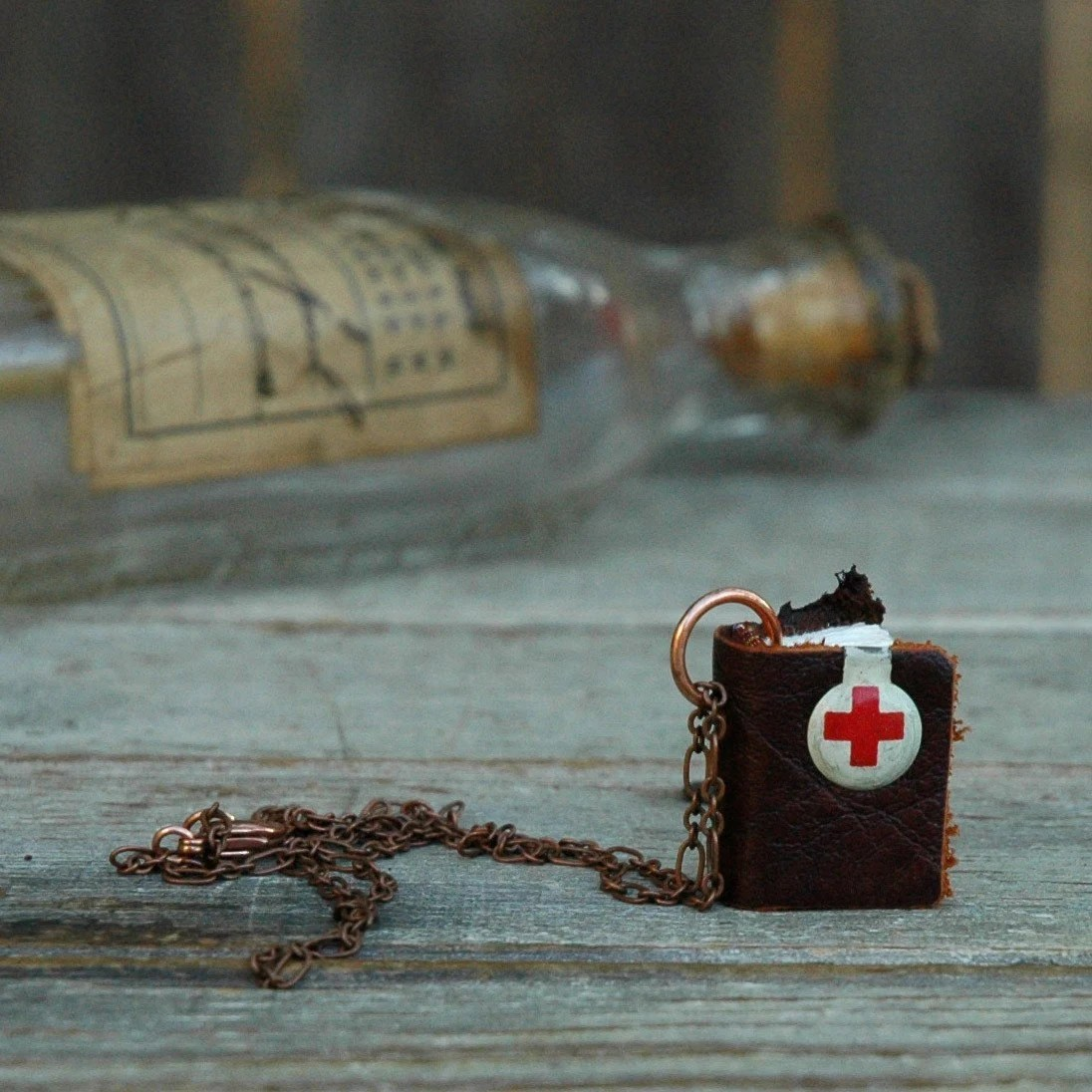 Red Cross antique beadge with flaming scrap leather book necklace