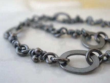 Magali bracelet. Sterling silver, knots and oval links, dark finish.